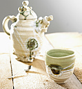 Pottery teapot with tea cup and spoon - SRSF00084