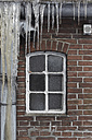 Germany, Hamburg, View of house window with icicles in foreground - TLF00422