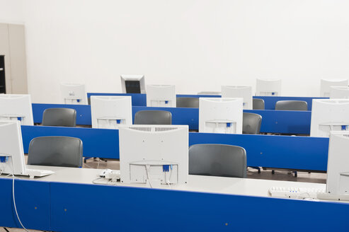 Germany, Emmering, Empty computer lab with computers - RNF00344