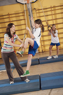 Germany, Emmering, Woman training girls - WESTF14635