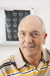Germany, Munich, Senior man smiling, portrait, close-up - WESTF14811