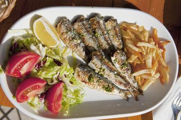 Spain, Majorca, Garnished grilled sardines in plate - NHF001252