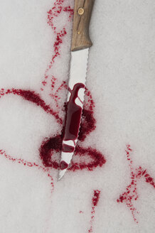 Germany, Close up of knife with blood in snowy winter - AWDF000599