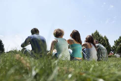 Germany, Munich, Man and woman sitting on grass - LDF000866