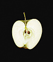 Half apple against black background - PSF000590