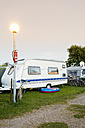 Germany, Mecklenburg-Western Pomerania, Silz, Camping trailer with parked bicycle - MSF002402