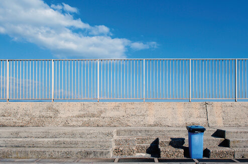 Italy, Sardinia, Cagliari, View of harbour with dustbin on stairs - LRF000512