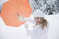 Austria, Altenmarkt, Woman holding umbrella, portrait - HHF003393
