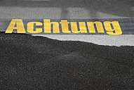 Germany, Text written on asphalt, close up - JMF000081