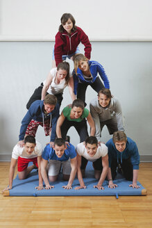 Germany, Berlin, Young people and teenager building human pyramid - BAEF000159