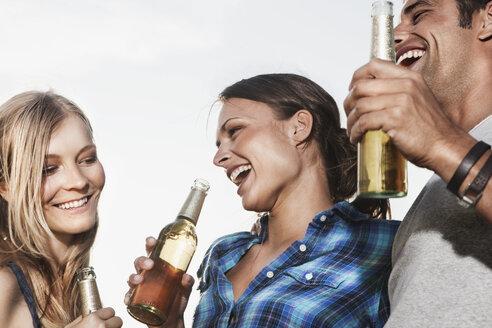 Germany, Cologne, Man and woman enjoying beer - JOF000174