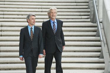 Germany, Hamburg, Businessmen walking together - WESTF015473