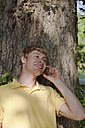 Germany, Dortmund, Young man on the phone, smiling - SKF000244