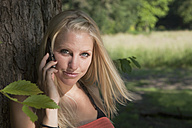 Germany, Dortmund, Young woman on the phone, portrait - SKF000247