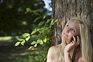 Germany, Dortmund, Young woman on the phone, smiling - SKF000253
