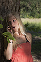 Germany, Dortmund, Young woman on the phone - SKF000289
