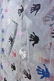 Germany, Berlin, Variety of handprints on berlin wall - WVF000052