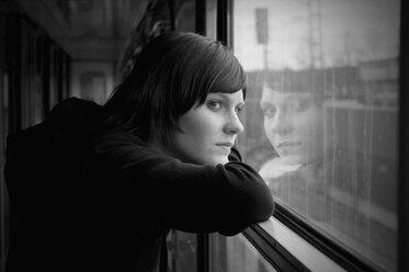 Czechoslovakia, Young woman looking through train window - WVF000067