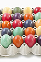 Variety of easter eggs in egg carton on white background - MAEF002482