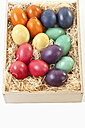 Variety of easter eggs in box on white background - MAEF002485