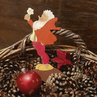 Basket of pine cones with bauble and santa claus - WBF000140