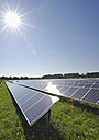 Germany, Bavaria, View of solar panels in field - WBF000105
