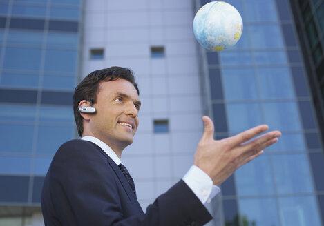Germany, Munich, Manager with small globe - WBF000528