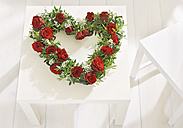 Heart shaped floral wreath on table for mother's day - WBF000242