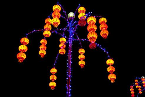 Malaysia, Penang, Illuminated light lantern at night - NDF000161