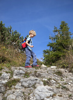 Germany, Bavaria, Boy (4-5 Years) walking on mountain - HSIF000008