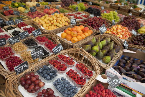 Germany, Munich, Variety of fruits in basket at market - SKF000410
