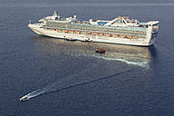 Europe, Greece, Thira, Cyclades, Santorini, View of cruise liner with small boats in aegean sea - FO002820