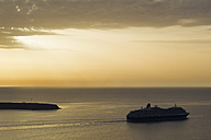 Europe, Greece, Thira, Cyclades, Santorini, View of cruise liner in aegean sea at sunset - FOF002767