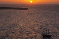 Europe, Greece, Thira, Cyclades, Santorini, View of sailing ships in aegean sea at sunset - FOF002775