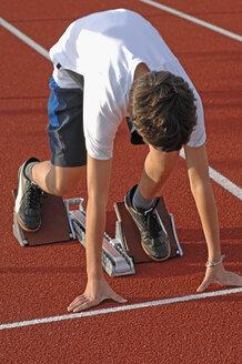 Germany, Baden-Württemberg, Mössingen, Runner ready at starting line - ASF004262