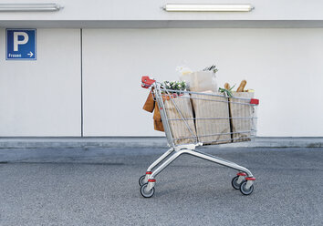 Germany, Shopping cart with groceries - WBF000446