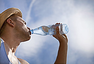 Croatia, Zadar, Young man drinking water from water bottle - HSIF000039