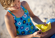 Croatia, Zadar, Girl making paper boat - HSIF000032