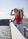 Croatia, Zadar, Young couple on bridge looking at view - HSIF000071