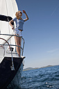 Croatia, Zadar, Young woman looking out from sailboat - HSIF000081
