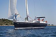 Croatia, Zadar, Friends relaxing on sailboat - HSIF000084