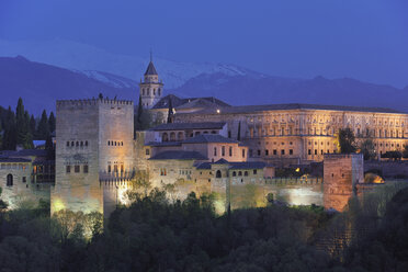 Spain, Andalusia, Granada Province, View of Alhambra Palace illuminated at dusk - RUEF000615