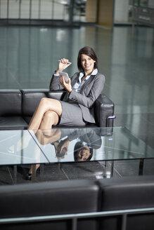 Germany, Bavaria, Business woman using PDAs - MAEF002723