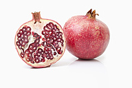 Sliced pomegranate in white background, close up - MAEF002835