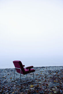 Austria, Salzkammergut, Mondsee, Outdoors chair by  foggy lake - WWF001771
