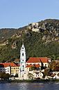 Austria, Lower Austria, Waldviertel, Wachau, Collegiate church by Danube river, Duernstein castle in background - SIEF000104