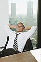 Germany, Frankfurt, Businessman resting in office - SKF000494