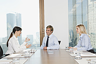 Germany, Frankfurt, Business people discussing in conference room - SKF000533