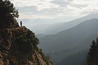 Germany, Bavaria, Senior woman at heimgarten and herzogstand mountain ranges - MIRF000077
