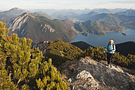 Germany, Bavaria, Senior woman at heimgarten and herzogstand mountain ranges - MIRF000080